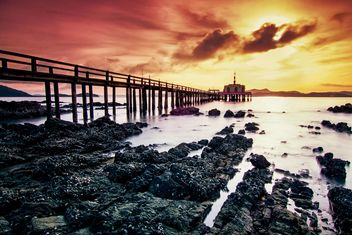 View of bridge in the sea at sunset - image #136307 gratis