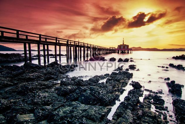 View of bridge in the sea at sunset - Free image #136307