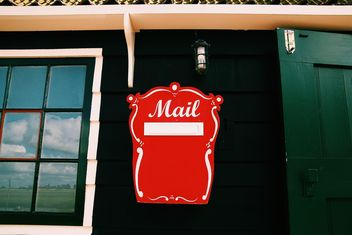 Mail box on wall of house - Free image #136497