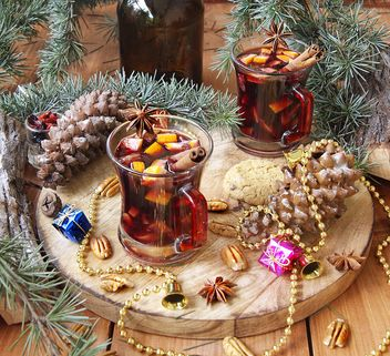 mulled wine in the cup and Christmas decorations - image gratuit #136647