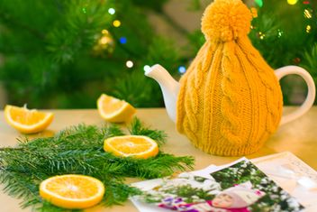 Teapot in knitted hat - image #182607 gratis