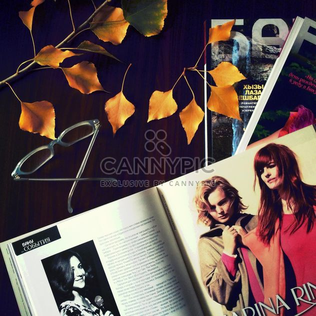 Open magazine, glasses and yellow leaves - Free image #182767
