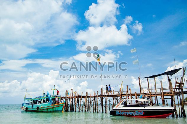 Boats moored near wooden pier - Free image #183847