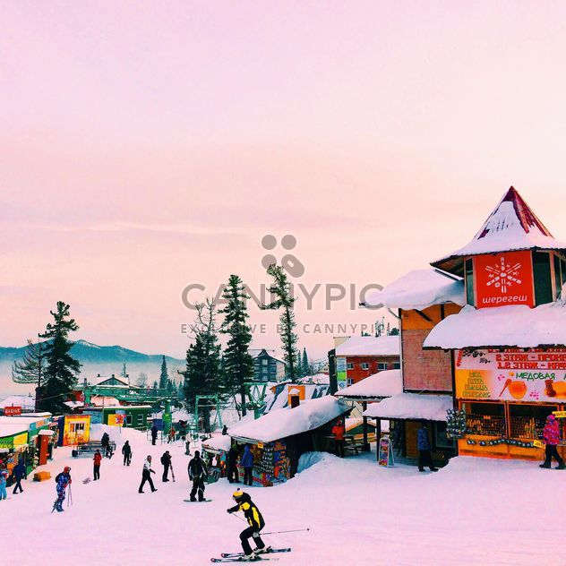 Tourists at ski resort in mountains - Free image #183977