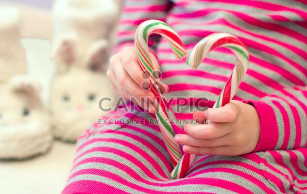 Candy cane in kid's hands - Free image #185817