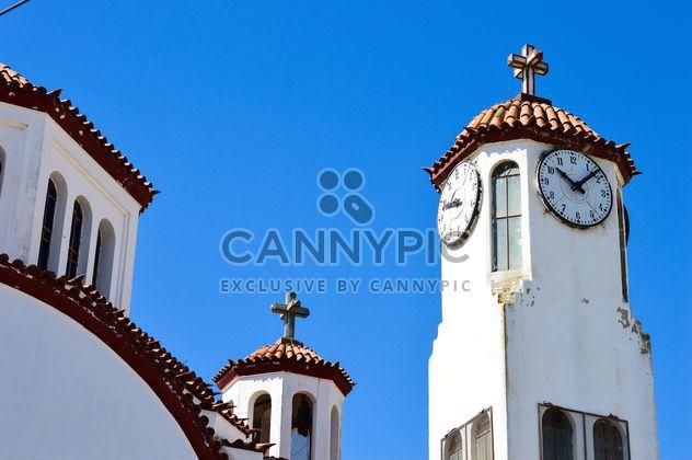 Башня с часами против голубого неба - бесплатный image #186247