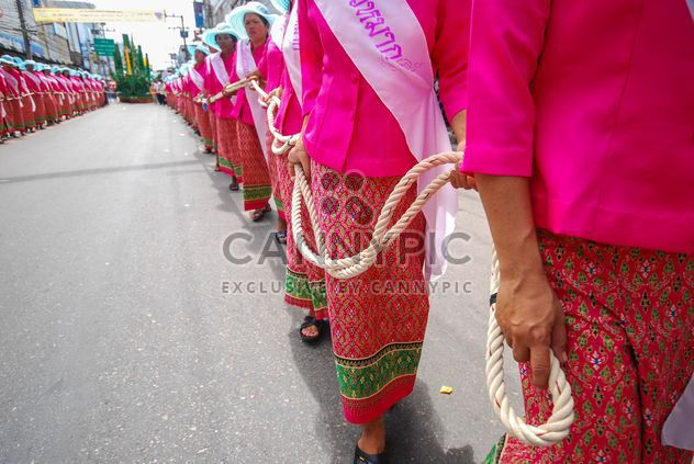 Women in pink clothes holding long rope - Free image #186327