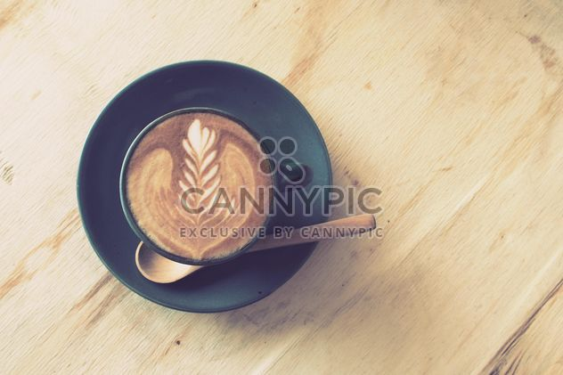 Coffee latte art on wooden table - Free image #187077