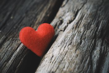 Red heart on wooden background - бесплатный image #187097