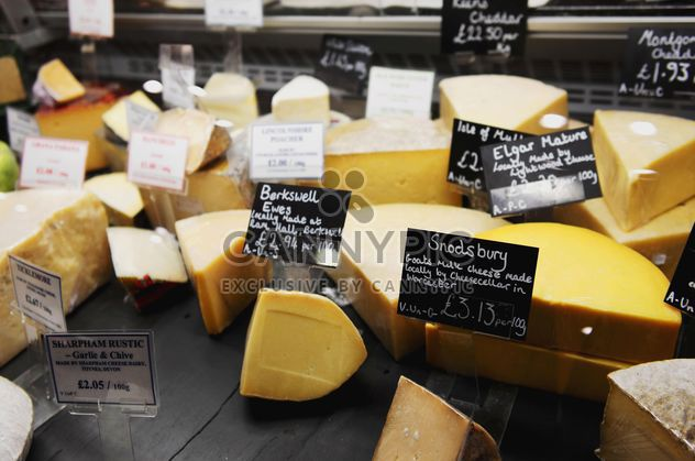 cheese on the counter in the store - Free image #198317