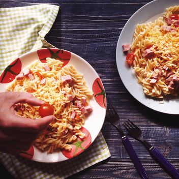 Two portions of pasta with cheese and tomato - image #198517 gratis