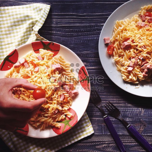 Two portions of pasta with cheese and tomato - Free image #198517