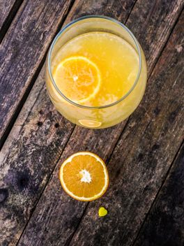 Orange juice on wooden table - image #198937 gratis