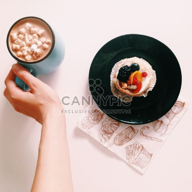 Cup of warm cocoa and dessert on the plate on white background - Free image #273827