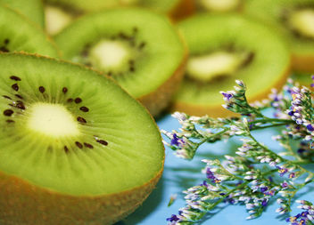 Free Pretty Green Kiwi Fruit on Aqua with Little Flowers Creative Commons - Free image #291617
