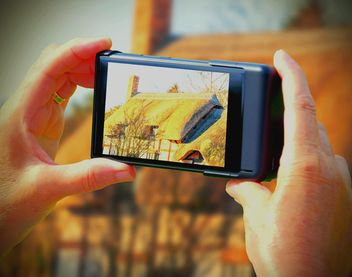 Holding smartphoneand taking picture - бесплатный image #297577
