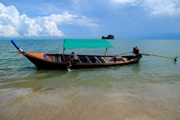 Fishing boat moored on a beach - бесплатный image #301707