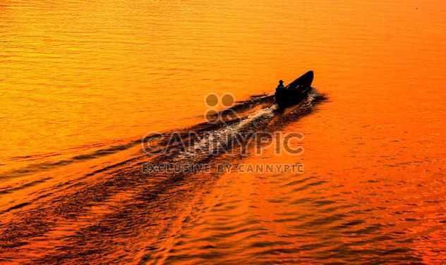 Fisherman in a boat - Free image #301757