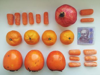 Orange set of vitamins and money on a white background - бесплатный image #304097
