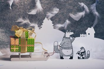 Paper cut foxes with gifts on sledge in winter - image #327307 gratis