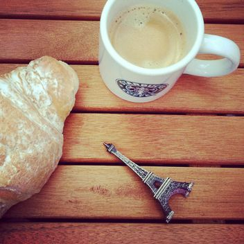 Cup of coffee, croissant and toy Eiffel tower - image #329117 gratis