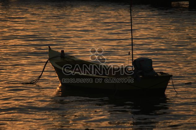 Boat on water at sunset - Free image #329997