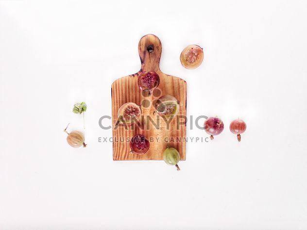 gooseberry on wooden desk - Free image #330717