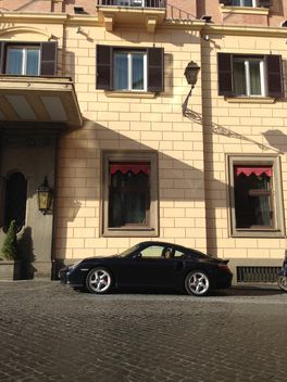Porsche parked near house - Free image #331287
