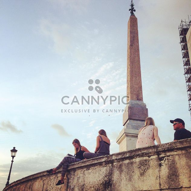 People sitting near Ancient Obelisk in Vatican - Free image #331627