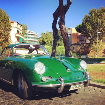 Green Porsche in the street - image gratuit #331687