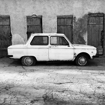 Old Zaporozhets car parked near old building - image #332107 gratis