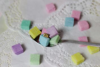 of Colorful Refined sugarcubes on a spoon - Free image #333567