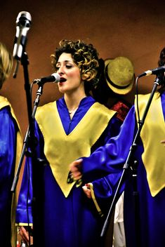 People in purple mantels singing gospel - image #333767 gratis