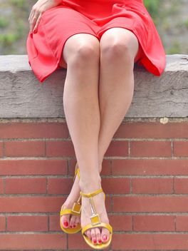 Girl legs with red dress and yellow sandals - бесплатный image #335177
