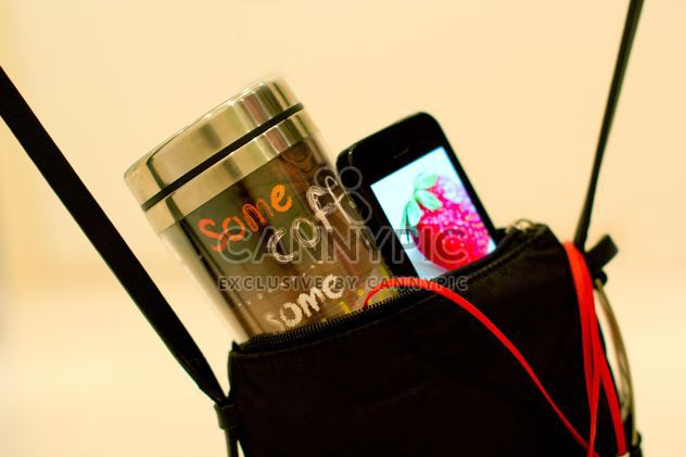 Cup of coffee and smartphone in handbag - Free image #337907