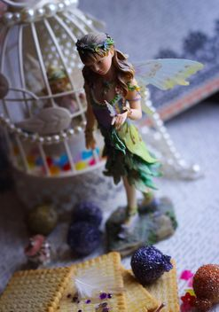 Ceramic fairy doll with white bird cage - бесплатный image #341487