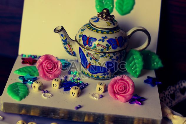diary, watering can decorated with flowers and ribbons - Free image #342117