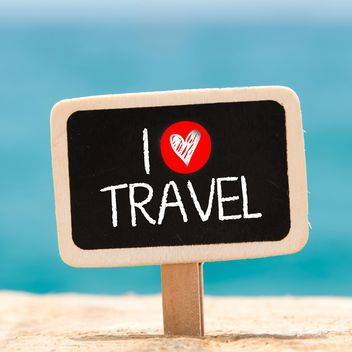 Sign I love travel on a blackboard sticking from the sand - бесплатный image #344027