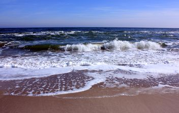 Black sea water waves the sand coast - image #344047 gratis