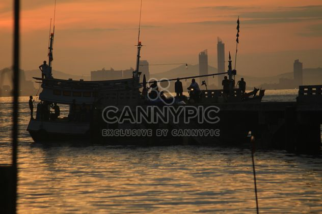 People and boat on sea at sunset - Free image #344517