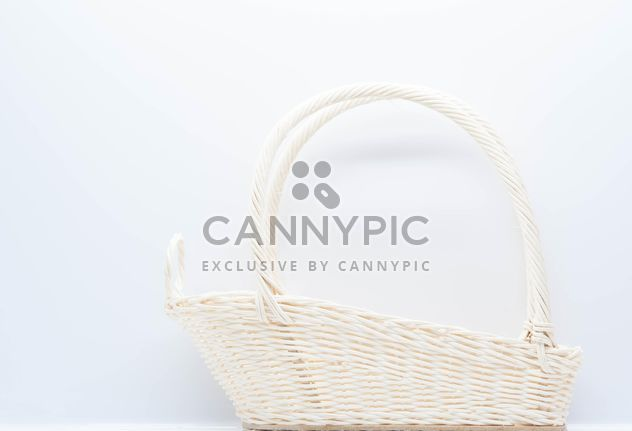 White wicker basket on white background - Free image #347237