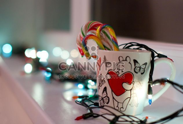 Christmas candies in cup and garlands - Free image #347907