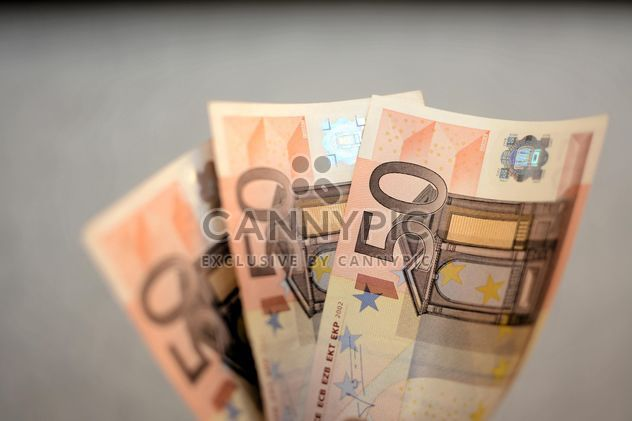 Closeup of Euro banknotes on grey background - Free image #348417