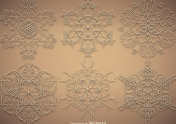 Vector Set Of Ornamental Snowflakes - Free vector #385417