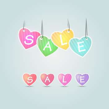 Colorful sale hearts on blue background - vector gratuit #127657