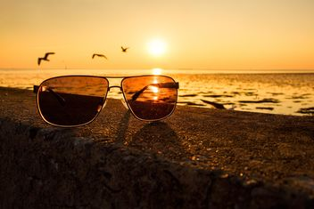 Sunglasses on a beach - image #136357 gratis