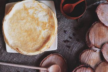 Pancakes, wooden stumps and spoons - image #136457 gratis