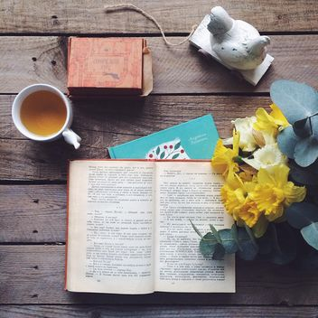 Cup of tea, candies and open book - image #136537 gratis