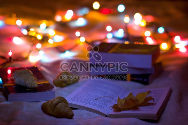 Books, croissants and garlands closeup - Free image #182567