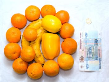 Fresh ripe fruit and money on white background - бесплатный image #182577